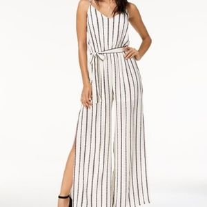 New with tags!  Adorable belted jumpsuit